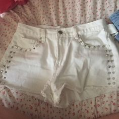 Forever 21 white studded jean shorts perfect condition! only warn once, they don't fit me anymore. no stains Forever 21 Shorts Jean Shorts