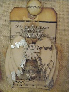 part of a Christmas advent by Uniquely ella / love the silver tipped wings, crown & glittered jingle bell