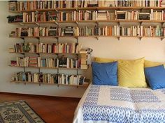 Looks a bit scary (what if the books fall!) but a handy solution. via apartmenttherapy.com