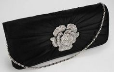 Large diamante flower detail to the front. Pleats and piping to the front flap, plain to the back. Lined with an internal pocket. 2 detachable chains measuring and Size (cm): 25 wide x 11 high x 7 deep Black Clutch Bags, Black Satin, Evening Bags, Classic Style, Dust Bag, Vintage Fashion, Crystals, Chains, Floral
