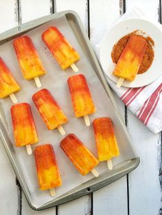 Turn the classic Mexican street treat known as a mangonada into popsicles with mango, orange juice, lime, chamoy and Tajín! Recipe via theothersideofthetortilla.com (Naturally gluten-free and vegan-friendly!)