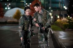 """Josh Peck (left) and Chris Hemsworth fight North Koreans in """"Red Dawn."""" Photo: Open Road Films"""