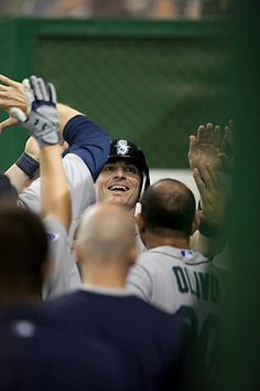 Brendan Ryan celebrates after he scores the winning run in the 11th inning for the Mariners.