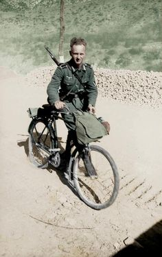 German soldier with bike and Gewehr 41 rifle. The lower class soldiers were in a bad condition.