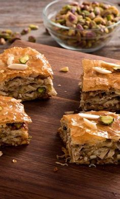 Almond Pistachio Baklava-Flavored with a hint of citrus and cinnamon, this easy to make, flakey Greek baklava recipe never fails to impress your friends.  Change the nuts to your own liking, the result will still be a delicious sweet treat! Serve at a holiday party or family get together, bring to a potluck or just make it for an after dinner dessert.