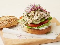 Tuna Everything Bagel : Tyler Florence turns up the volume on your standard bagel and cream cheese by using halved everything bagels for his tuna sandwiches. Red onion and cucumber add a nice hearty crunch.