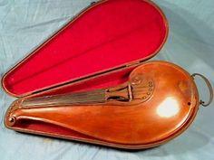 A uniquely designed Folk Violin, in original case in near mint condition.