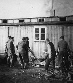 """On orders from the U.S. Army, Austrian citizens remove corpses from the """"Russian camp"""" section of Mauthausen for burial in a mass grave.  Photo credit: Karl. H. Wyneken Collection, courtesy of USHMM Photo Archives"""
