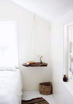 """Small Space Illusion: DIY Hanging Tables """"Here's a little trick for keeping small rooms from showing their size: the more floor you see, the bigger the room looks. (It's why designers recommend sofas and chairs with legs that lift off the floor.) You can use that principle anywhere —the bedroom, living room or outside — to justify taking your tables off the floor and hanging them from the ceiling instead."""""""