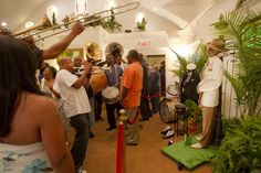 CHRIS GRANGER / THE TIMES-PICAYUNE The dead body of Lionel Batiste, right, is embalmed and propped up against a pole during his wake on Thursday, July 19, 2012 at Charbonnet-Labat Funeral Home in New Orleans.