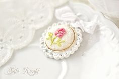 A simple embroidery effort creates a lovely girly pendant. Embroidery Motifs, Simple Embroidery, Silk Ribbon Embroidery, Cross Stitch Embroidery, Embroidery Designs, Textile Jewelry, Love Sewing, Embroidery Techniques, Handicraft