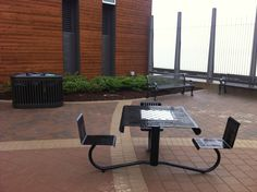 is shown here at the Halifax Port Authority Waterfront in Halifax Nova Scotia. The checker board table with the adjoin seats brings a great uniqueness to the installation. Checkerboard Table, Ipe Wood, Checker Board, Steel Panels, Street Furniture, Nova Scotia, Picnic Table, Custom Furniture, Tables