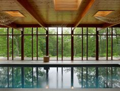 Hudson Valley Country House The outdoor meets the indoor with this 40 foot ozone-filtrated pool  Lighting by Ingo Maurer