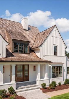 Modern Farmhouse exterior with classic elements such as Painted Brick Board and . - Modern Farmhouse exterior with classic elements such as Painted Brick Board and Batten Siding Cedar - Modern Farmhouse Exterior, White Farmhouse, Farmhouse Design, Farmhouse Style, Farmhouse Trim, Southern Farmhouse, Farmhouse Architecture, Farmhouse Remodel, Southern Living