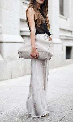 Wide pants and black top.
