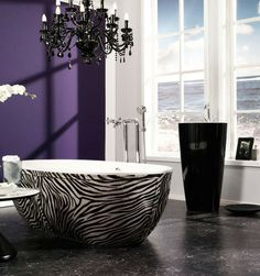 Zebra tub, chandelier, royal purple, marble floors, a view of the ocean *sigh*