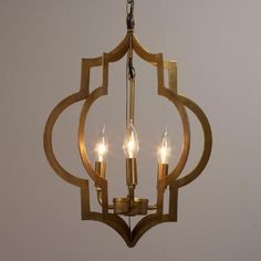 Our Moroccan-inspired pendant is designed for use with three candelabra bulbs and features two quatrefoil symbols finished in elegant antique gold. Ideal for filling small spaces with light and warmth, this architectural pendant is an affordable alternative to a chandelier.