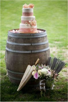 Rustic Wedding - Display your cake on a weather-beaten wine barrel strewn with rose petals, or drape flower garlands off it for a softer feel.