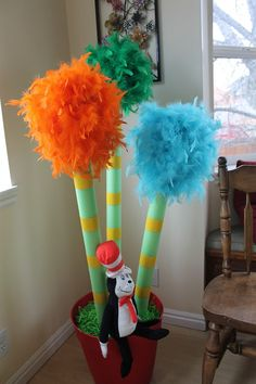 Dr. Suess Baby Shower: Truffla tree out of pool noodles and colored boas.