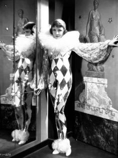 Tonight is Ours - Claudette Colbert as Princess Nadya wearing a sequined Pierrot costume with huge diamanté tulle ruffled collar and chiffon sleeves. The costumes were designed by Travis Banton. Pierrot Costume, Pierrot Clown, Jester Costume, Cirque Vintage, Vintage Clown, Vintage Circus Costume, Vintage Costumes, Vintage Witch, Cabaret Vintage