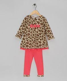 Styled with lively leopard spots and a trio of rosettes, this trendy twosome is an easy-peasy treat for small ones. The swingy tunic features exposed stitching and ruffled trim, while the coral-color leggings are sublimely simple to sport.