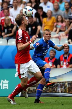 #EURO2016 Marc Janko of Austria heads the ball away from Emil Hallfredsson of Iceland during the UEFA EURO 2016 Group F match between Iceland and Austria at...