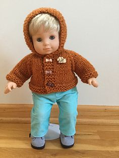This pattern is a quick-to-knit top-down sweater that fits Bitty Baby. It is knit in worsted weight yarn on size 9/5.5 mm needles.