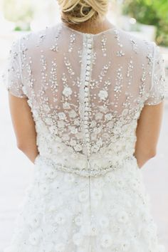 Flower applique winter wedding dress: http://www.stylemepretty.com/2015/11/08/winter-wedding-dresses-perfect-for-a-snowy-day/