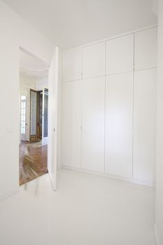 Image 11 of 19 from gallery of Napoleon Flat / FREAKS freearchitects. Photograph by David Foessel Hallway Cupboards, White Cupboards, Bedroom Cupboards, Hallway Storage, Bedroom Closet Design, Bedroom Wardrobe, Built In Wardrobe, Scandi Bedroom, Bedroom Decor