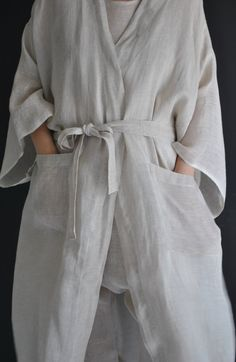 Handwoven linen Kimono, Robe in a loose modern style, with 2 front pockets, in finest linen. This Kimono comes in 2 colors only. The size is very loose which means, it fits most sizes. ( This price is for the Kimono only ) Material: finest handwoven linen Care: pre washed and ironed Handmade in Sweden ÅSA, our model, wears a size* L *on our picture. A GENERAL SIZE CHART (body measurements): SIZE XS Bust: fits bust around 84 cm / 33 Waist: fits waist around 66 cm / 26 Hips: fits hips...