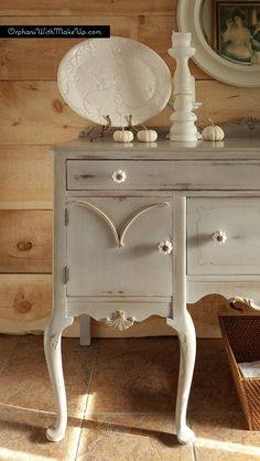 Queen Anne sideboard against wood plank walls