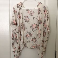"""Floral kimono Only used twice. This was my daughter's and she decided she no longer wants it. Still like new, no flaws. It's short-sleeved, an off-white color, and is lightweight. Great for Spring just around the corner. Measures to 23"""" from top to bottom. Size small, but still great for a medium or large since it's flowy. Forever 21 Sweaters Cardigans"""