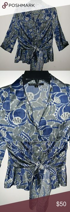 "Lafayette 148 New York Button Down Tie-Font Blouse Gorgeous silk blend blouse V neck button down with 3/4 sleeve. It is in excellent condition. Measurements Flat lay: Bust 19 1/2"", lenght 25"" Lafayette 148 New York Tops Blouses"