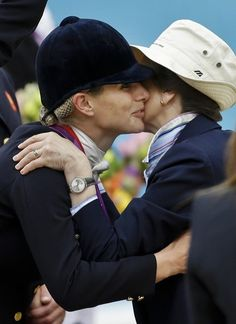Britain's Zara Phillips, left, is kissed by her mother Princess Anne, right, as she receives a medal from her after Britain won the silver in the team equestrian eventing competition at the 2012 Summer Olympics, Tuesday, July 31, 2012, at Greenwich Park in London.