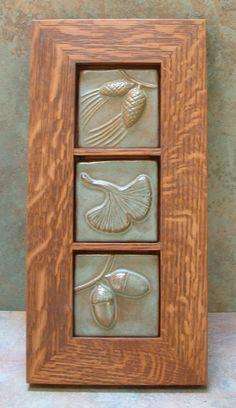 3 Framed Tile, tiles, pine-cone, gingko leaf & acorn tile with green glaze. Craftsman/Mission/Bungalow/Arts and Crafts style Craftsman Frames, Craftsman Tile, Mission Furniture, Craftsman Furniture, Bungalow, Carport Designs, Arts And Crafts Movement, Decorative Tile, Tile Art