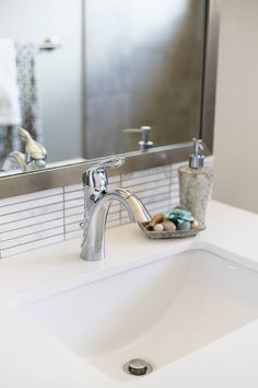 simple faucet.  Also like backsplash tile and simple chrome mirror edging