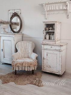 White chair. Chippy white furnishings.