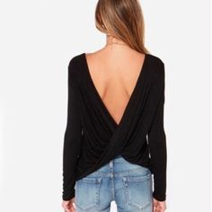 Open Back Shirt Gorgeous open back black shirt!! Stretchy material and will look SO Great paired with your favorite pants/jeans and heels for a night out!! Available S,M,L Let me know what size you would likes and I'll make you a seperate listing Tops Blouses