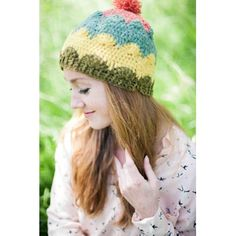 UK and US terminology given.Stripes and the shell stitch are used to create a striking colourwork scallop pattern in this deceptively simple but pretty hat. Intermediate level - raised stitches are used.(Actual shades used in the sample are Bracken and Laurel instead of Moorgrass and Dewdrop.)