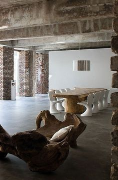 get a load this space..... giant concrete beams.. exposed brick.. concrete floors & contemporary decor