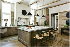 """My new favorite kitchen. If I were to build my own kitchen tomorrow I would use this """"pickled"""" wood stain. Beamed ceiling, stucco hood, planed wood walls"""