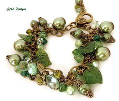 This unique Victorian bracelet has so many shades of Green. Just prefect for the Fall and Winter Season. The center of the bracelet has an