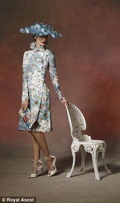 Many of the looks feature full brimmed hats as fascinators are not permitted in the Royal Enclosure. Pictured: a model in a floral Erdem dress