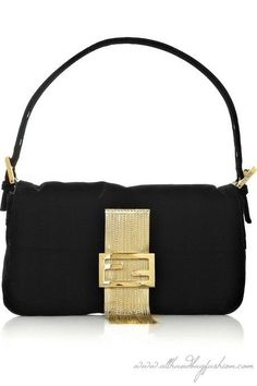 f715175ca7e1 Bring this  Fendi baguette on a date to a fancy French restaurant! Clutch  Bag
