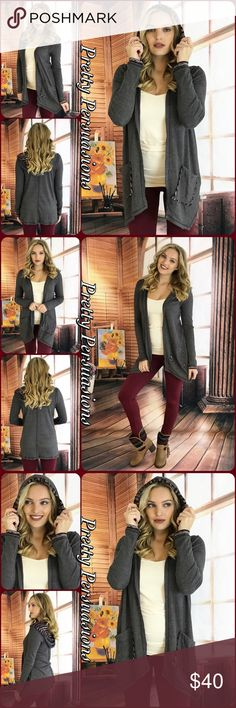 """NWT Charcoal & Burgundy Hooded Thermal Cardigan NWT Charcoal & Burgundy Hooded Thermal Cardigan Sweater  Available in S, M, L Measurements taken from a small  Length: 29"""" Bust: 44"""" Waist: 50""""  Cotton/Poly Blend  Features  • hooded • front pockets • charcoal gray exterior w/burgundy accented hood & trim • soft, cozy material  • long sleeves  • open front  Bundle discounts available  No pp or trades  Item # 1/1011300390CBHC cozy sweater weather long cardigan hoodie Pretty Persuasions Sweaters…"""