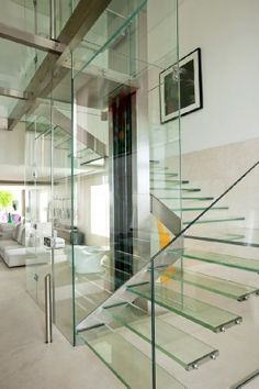 Stair around Elevator design | Designing those transparent, glass stairs and the elevator was the ...