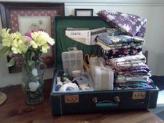 i found this OLD suitcase in the attic...had travel ticket on it from the 1930's...thanks pinerest for such a great idea of turning it into a sewing basket!
