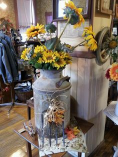 Antique milk can with sunflowers.
