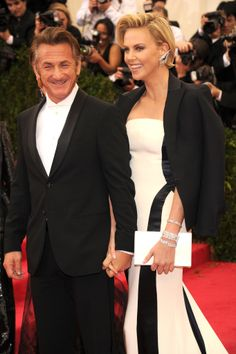 Charlize Theron Brings Sean Penn to the Met Gala  Love both of them!