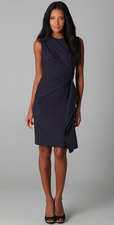 This scoop-neck DVF dress features asymmetrical pleating at the bodice. Cascading ruffle and slit at skirt. Velcro® closure at side and topstitched elastic belt at back. Exposed shoulder zip and hidden side zip. Sleeveless